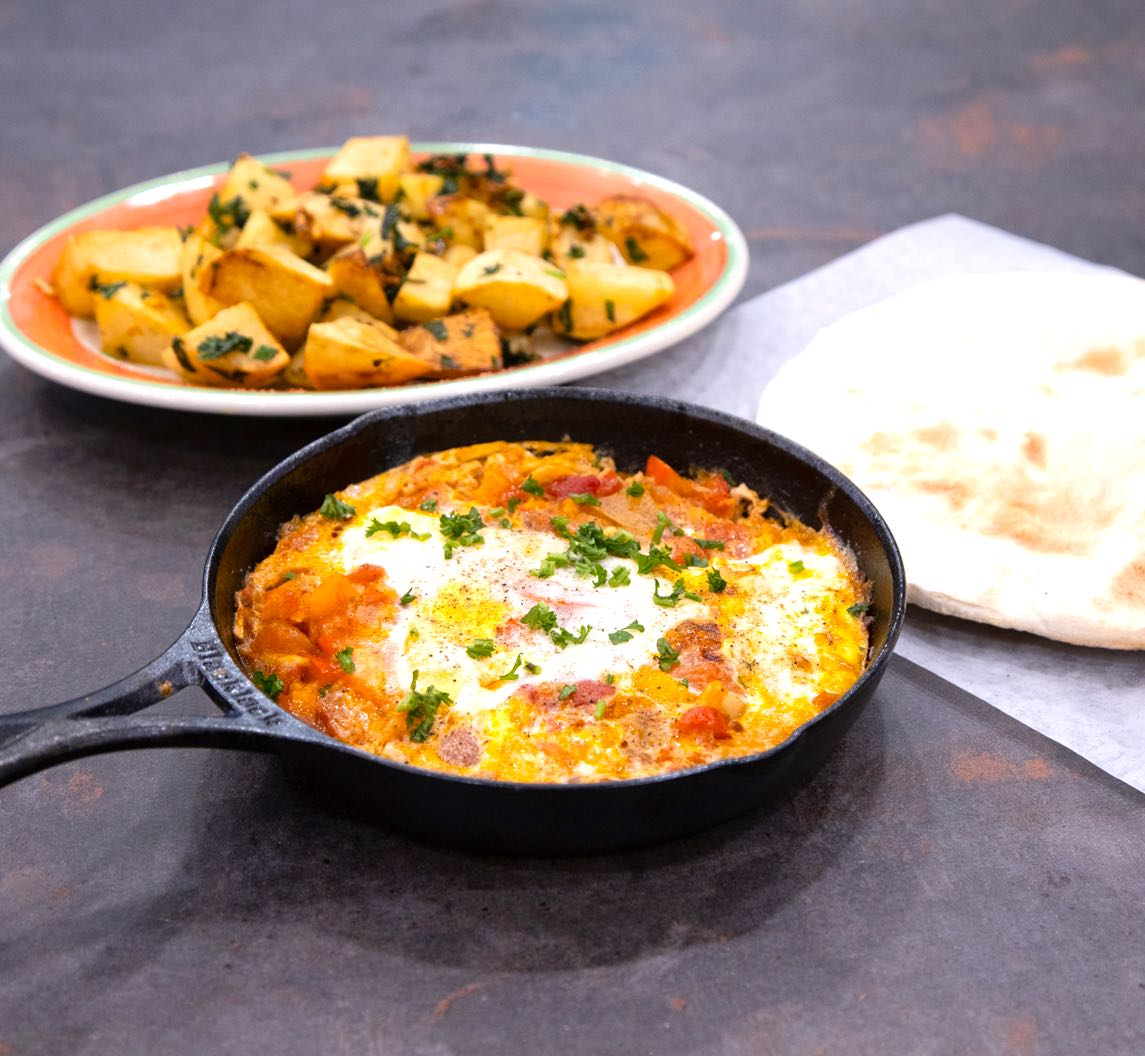 Shakshuka with potatoes and bread