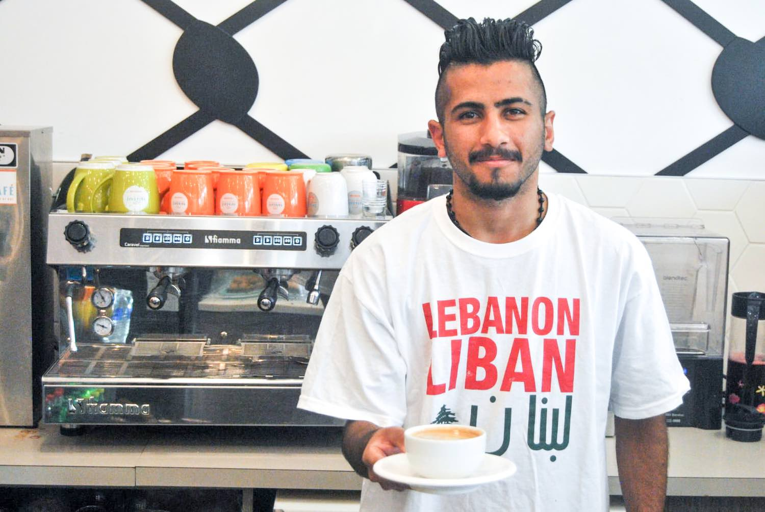 Server wearing Lebanon t-shirt